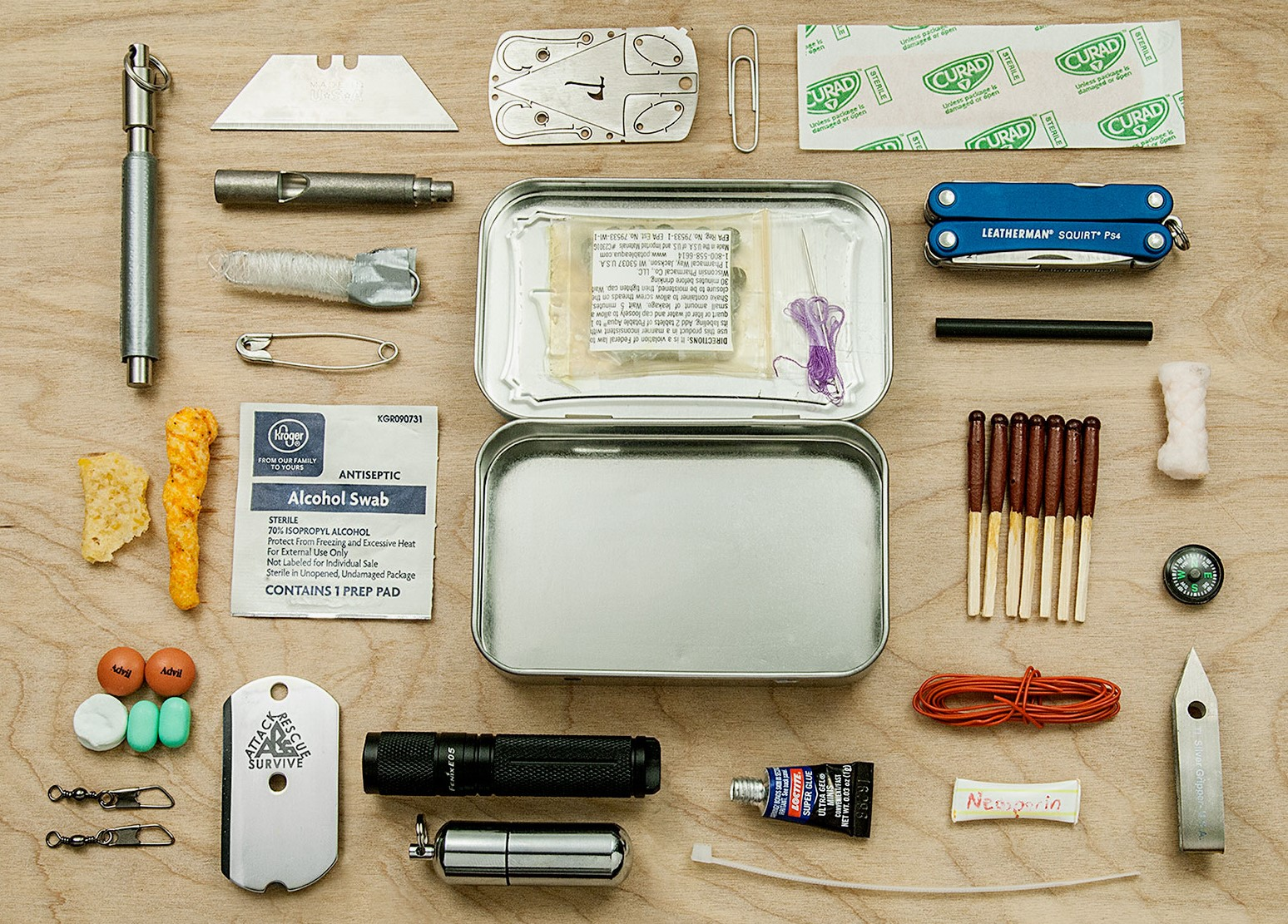 Exploded Altoids Survival Tin